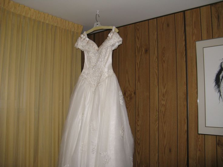 I have this beautiful wedding gown  I got it from somewhere in Minnesota, and has a catherial train attach ballroom gown two tone color silk with lace very beautiful everything is included I have  other pictures, etc if any one is interested buying it please let me know, its size 4 petite, hoop slip and beaded long veil, and purse and gauntless gloves plus  shoes etc,