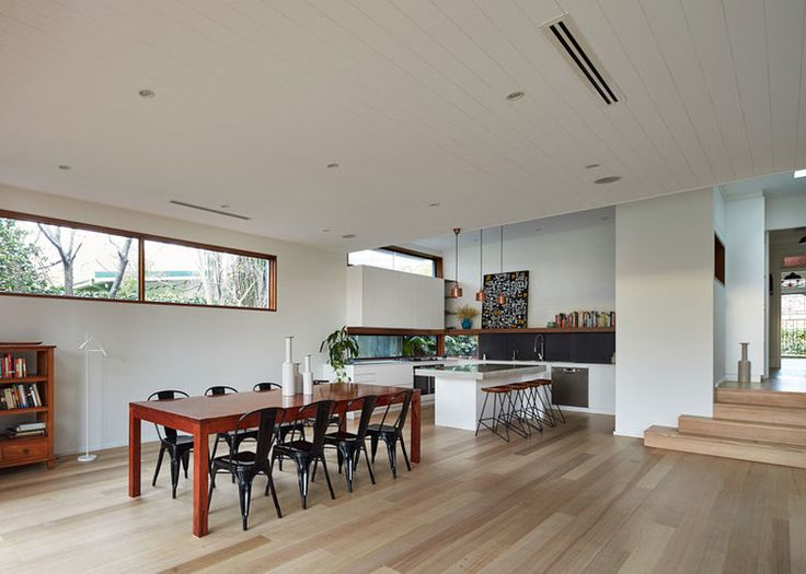 Open plan living kitchen at Step Down House in Willoughby Sydney — Bijl Architecture