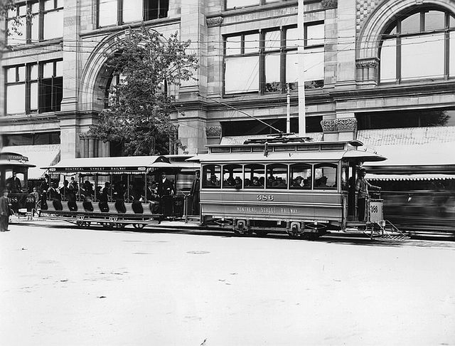 Electric trams pass by the Wm Notman & Son store, which is now Ogilvy's Department Store, on Saint Catherine Street, in Montreal Quebec, Canada (circa 1895) ~ Photo from The McCord Museum Archives©