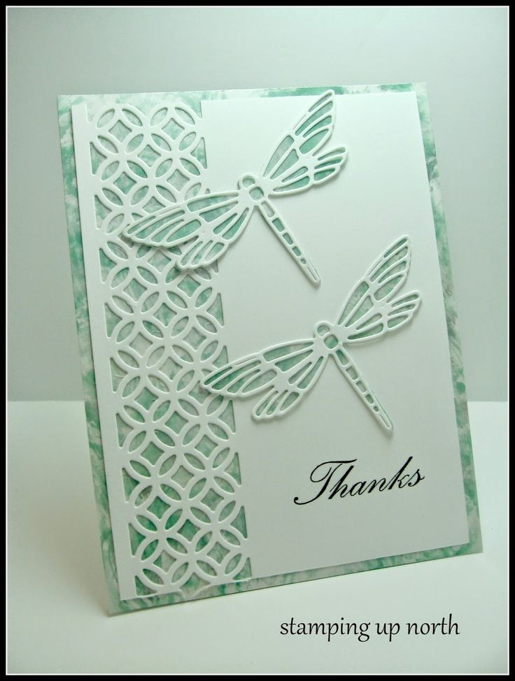 handmade card from stamping up north ... white and mint ...background on top of printed paper ... wide punched trellis border ... dragonfly die cuts ... beautiful!