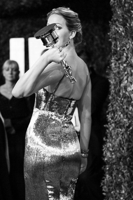 Jennifer Lawrence with her Oscar for Best Actress in Silver Linings Playbook, Vanity Fair Oscar Party 2013.