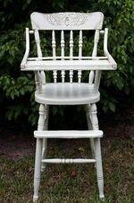 White antique high chair.