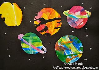Paper painted while listening composer Gustav Holst's The Planets - and then cut into shapes for planets etc.