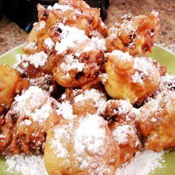 Oliebollen (dutch doughnuts)  We ate them every New Year's Eve...