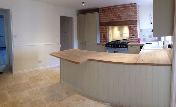 We are getting close now... ! Burford grey howdens kitchen with solid oak worktops with breakfast bar