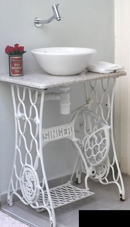 Reusing an old sewing machine as a base for the bathroom sink (remember tip for a future beauty desk!)