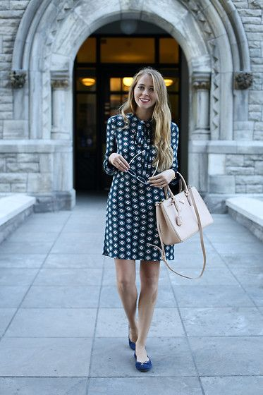 Get this look: http://lb.nu/look/8515029  More looks by Natalie Ast: http://lb.nu/natalieast  Items in this look:  Marks & Spencer Bow Neck Dress, Prada Double Zip Tote   #chic #classic #elegant #ootd #wiwt #prada #dress