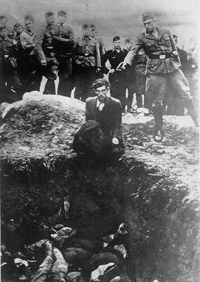 The History Place - Holocaust Timeline: SS Einsatzgruppen -Waffen-SS men and young members of the Reich Labor Service look on as a member of Einsatzgruppe D is about to shoot the last Jew left alive at Vinica, Ukraine, as he kneels on the edge of a mass grave.