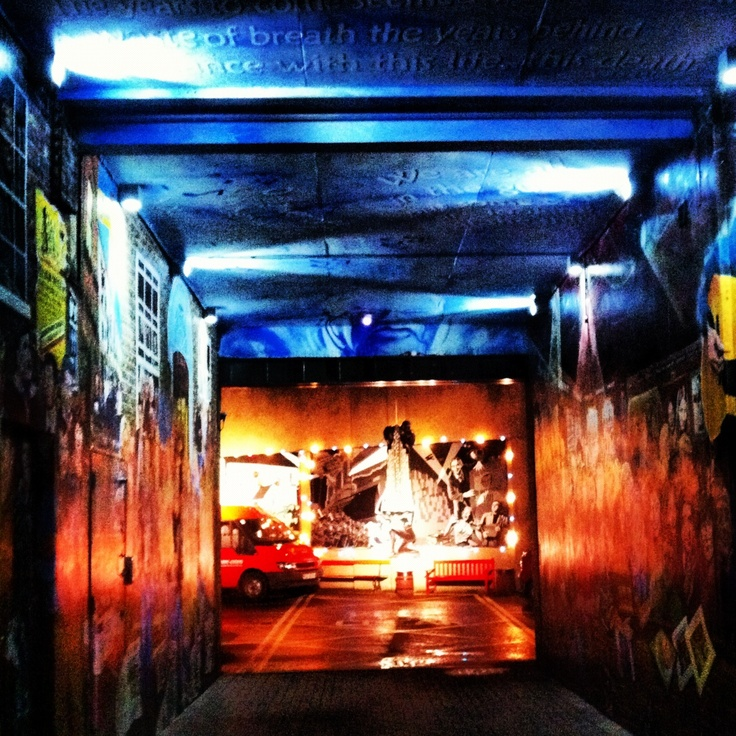 Street tunnel in Belfast which was painted with murals and graffiti and lit up pretty nice.