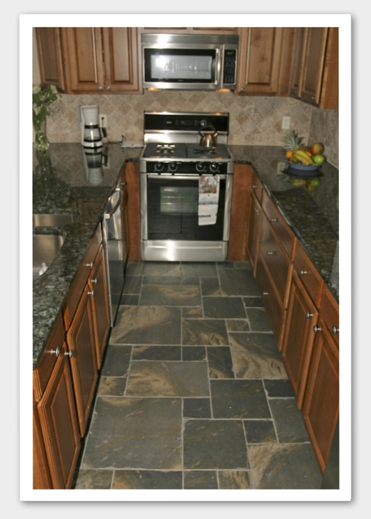 Tile floor medium brown cabinets tile backsplash for Brown kitchen cabinets with black appliances