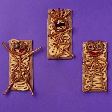 Pretzel Skeletons - Midwest LIvingHalloween Parties, Food Piece, Cheese Spreads, Pretzels Sticks, Halloween Treats, Graham Crackers, Colors Food, Roasted Red Peppers, Pretzels Skeletons