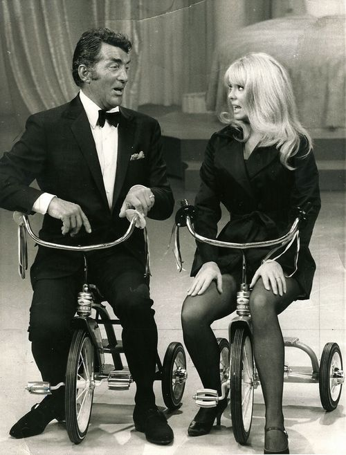 Dean Martin absolutely knew how to ride a bike, but when he had Joey Heatherton on his TV show, it was a lot funnier if they each rode tricycles - NBC-Burbank Studios ca 1967