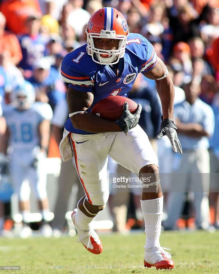 Wide receiver Percy Harvin #1 of the Florida Gators runs for a touchdown in the second quarter against the Citadel Bulldogs during the game at Ben Hill Griffin Stadium on November 22, 2008 in Gainesville, Florida.