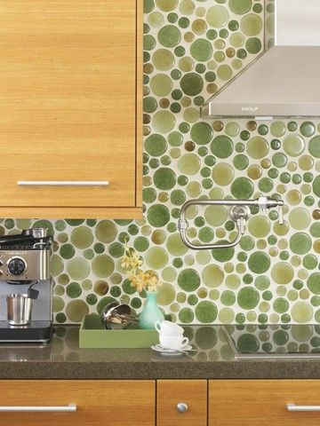 Round recycled glass backsplash. Love the circles & colors... Wonder where else besides backsplash this could work well.