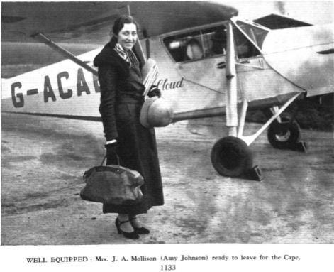 Amy Johnson Mollison, CBE, with her de Havilland DH.80A Puss Moth, G-ACAB, The Desert Cloud, Lympne Aerodrome, London, 14 November 1932. (Flight)