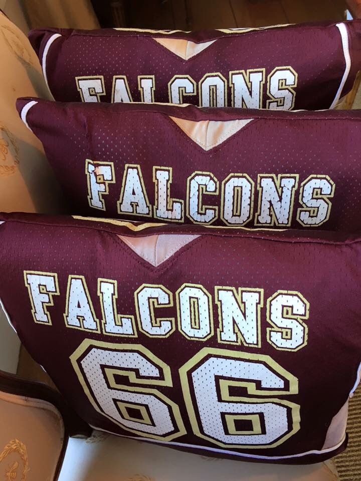 Youth football jerseys turned into keepsake pillows by Bitty Birdie Design