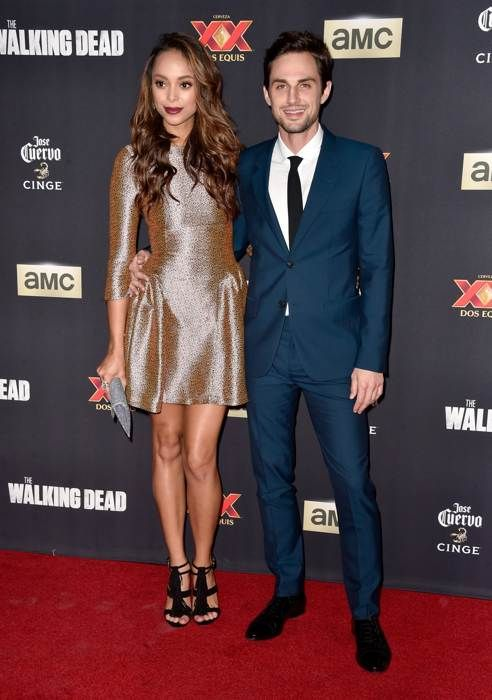 Amber Stevens and Andrew J. West attend the Season 5 premiere of The Walking Dead at AMC Universal City Walk on October 2, 2014 in Universal City, Ca