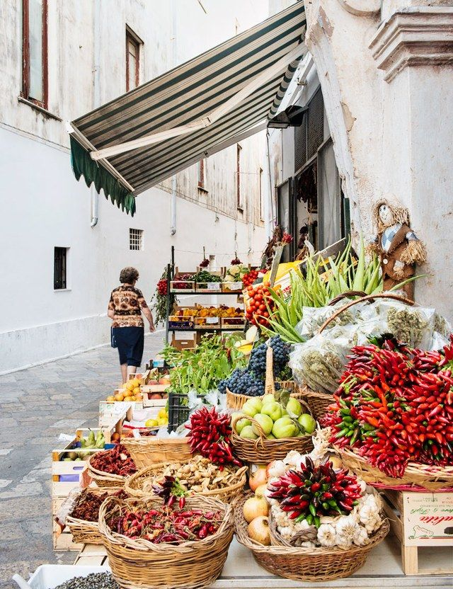 Heading to Italy? We recommend Puglia. This market-lined street is in Gallipoli, a town on Salento's west coast. | archdigest.com
