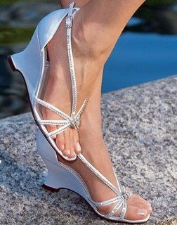 Pretty shoes for the ceremony...easier to walk in grass in a wedge than in a heel.