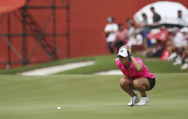 Danielle Kang of the United States lines up her putt on the 2nd hole during the third round of the Sime Darby LPGA golf tournament at Tournament Players Club (TPC) in Kuala Lumpur, Malaysia, Saturday, Oct. 28, 2017. (AP Photo/Sadiq Asyraf)