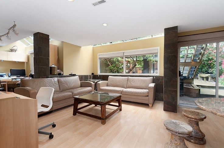 Open space concept is pronounced by plenty of natural light from two long rows of skylights. Sizable windows and glass patio doors furthermore expand charming indoors into lush, scenic outdoors.    #Vancouver #Accomodations #Hotels #Kitsilano