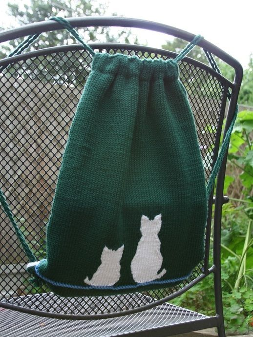 Contoured intarsia cats on a backpack
