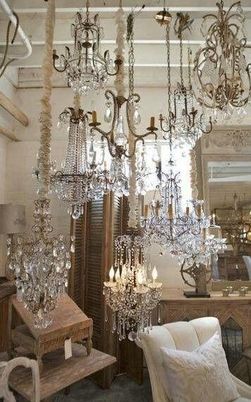 Visual merchandising. Antique / Vintage / Resale store display. Vintage chandeliers. Lighting.