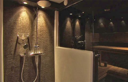 Mosaic wall behind showers