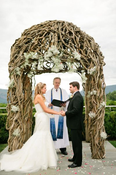 Rustic wedding arch: http://www.stylemepretty.com/little-black-book-blog/2014/12/31/elegant-wedding-at-the-garrison/ | Photography: Lindsay Madden - http://lindsaymaddenphotography.com/