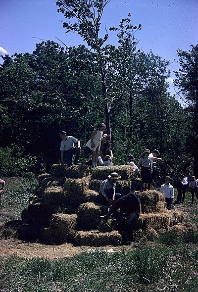 Children playing on hay bales at Allan Kaprow's Tree Happening on George Segal's farm, 1963 May 19,  unidentified photographer. Caroline Lerner Goldsmith papers related to Allan Kaprow, Archives of American Art, Smithsonian Institution.