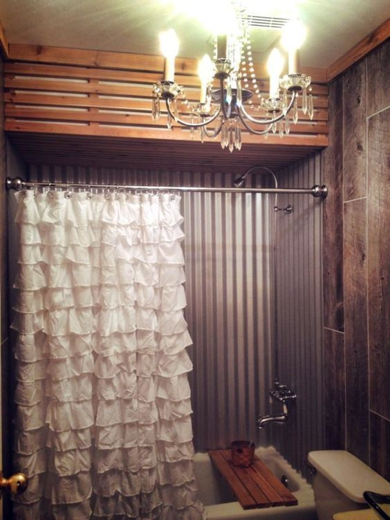 Love the ruffled shower curtains.  Fancy Rustic Elegant all in one Bathroom~, A little sneak peek of our latest re-do~ Our bathroom!! Shabby Rustic Elegant Industrial and a little bit Country all in one~!~ We have taken corrugated metal and softened it up with a ruffle shower curtain with a cedar rustic ceiling. The exposed pipes and vintage faucet add character. Vintage chandelier lighting.: