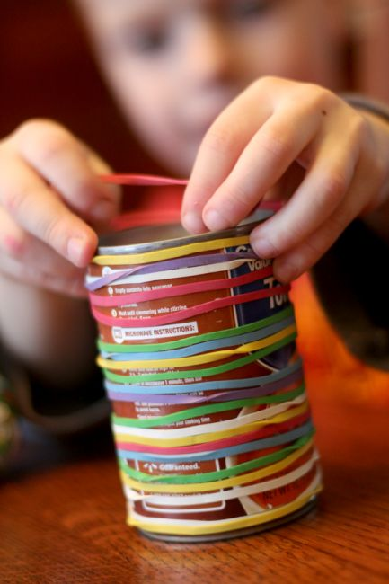 Great way to keep kids busy - just rubber bands and a soup can from the pantry! Great fine motor activity!