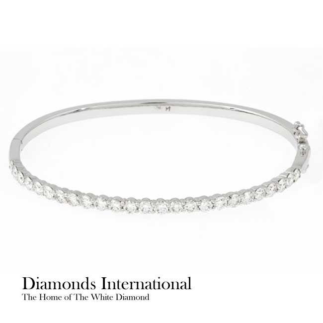 18ct white gold Diamond set hinged bracelet set with 25 x Round Brilliant Cut Diamonds = 2.38ct each four claw set. Product Reference G1641. #diamondsinternational #love #diamonds #bracelet #bangle #white #gold #clawset #roundbrilliantcut #australia #anniversary #birthday #girlfriend #wife