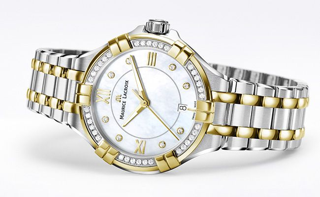 Baselworld 2016 novelties: AIKON Ladies 35mm  The round case of the new AIKON features a prominent bezel, incorporating six 'arms' which embrace its form. This aspect of the design confers a unique contrast. On one hand, the arms represent strength and robustness while, conversely, they characterise a caring and loving embrace.  #MauriceLacroix