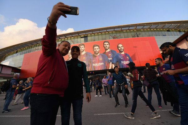 Fans take a selife photograph outside the stadium prior to the UEFA Champions League Group D match between FC Barcelona and Juventus at Camp Nou on September 12, 2017 in Barcelona.