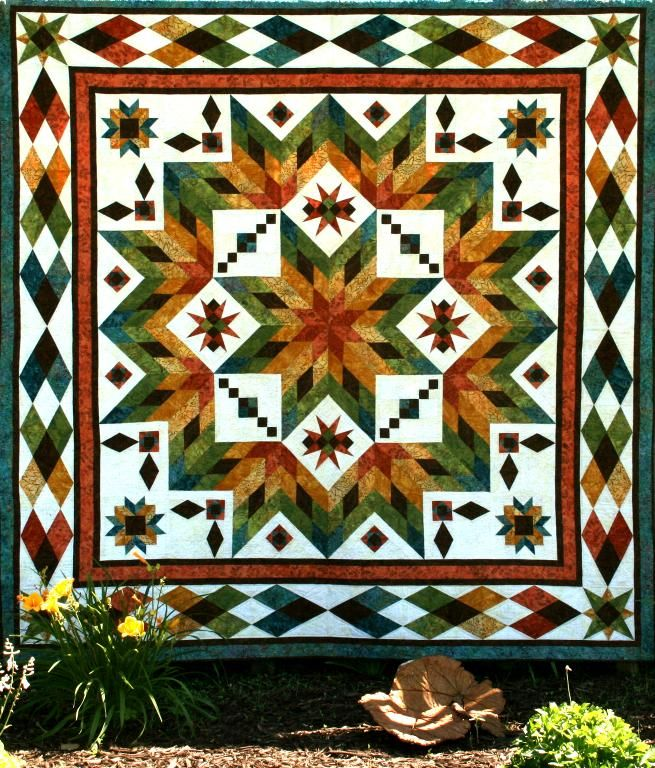 This broken lone star quilt is a stunner is made with sumptuous batik fabrics