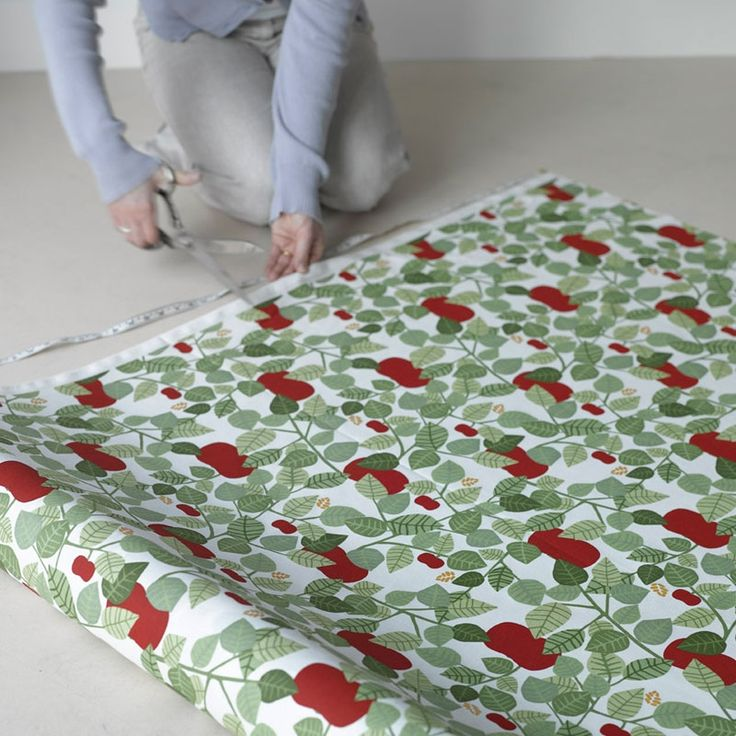 The vintage design, Red Orchard is a classic Swedish design featuring red apples and green leaves...perfect for bringing the outdoors indoors...make lovely curtains, Roman blinds or cushions.  100% cotton and from www.newhousetextiles.co.uk