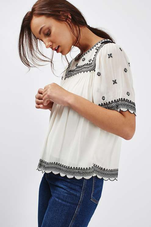 Be a bohemian dream in this cute flute sleeve tee with embroidered detail. We love the comfy, relaxed fit and summer-friendly white hue. Wear with flared jeans for a full 70s inspired look. #Topshop