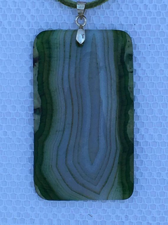 Oblong shades of green onyx agate pendant