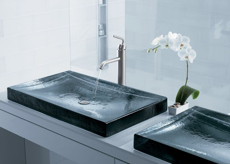 Crafted of cast glass, the Antilia Wading Pool basin makes a distinctive statement of quiet luxury, in an expansive design that becomes a centerpiece in your bath.