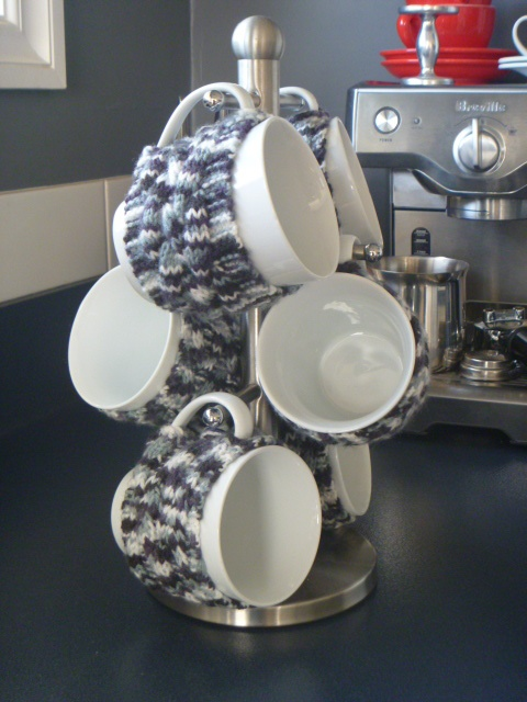 Just in case my coffee cups get cold this Winter, they are all modeling hand knitted 'Jersey's', each with it's own cable pattern and individual buttons at the handle. Knitted with garter stitch edges in 8ply acrylic they will all look very chic no matter if it's tea or coffee, day or night!