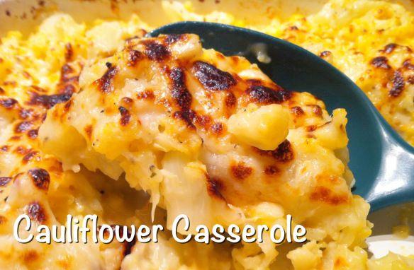 1 Head of Cauliflower, cut into pieces 1/2 C water Garlic Powder, Salt, Pepper 2/3 C Shredded Sharp Cheddar Cheese 1/2 C Shredded Mozzerella Cheese 1/2 C Milk