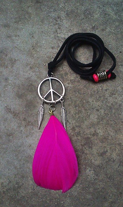 Peace pendant with 2 feather charms & magenta feather.  https://www.facebook.com/featherprojectlk/