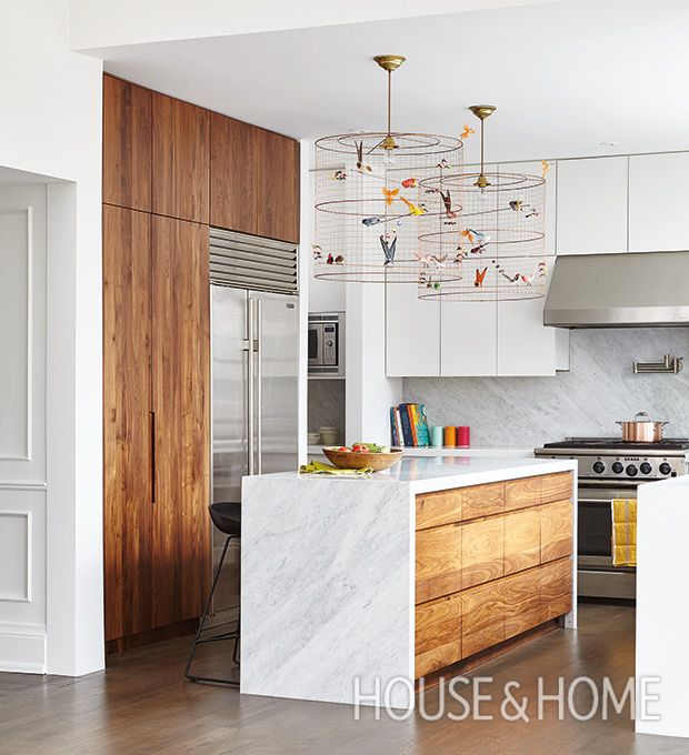 This stunning west end Toronto kitchen includes a full pantry wall and small servery. | Photographer: Valerie Wilcox | Designer: Pivot Design, Designtheory