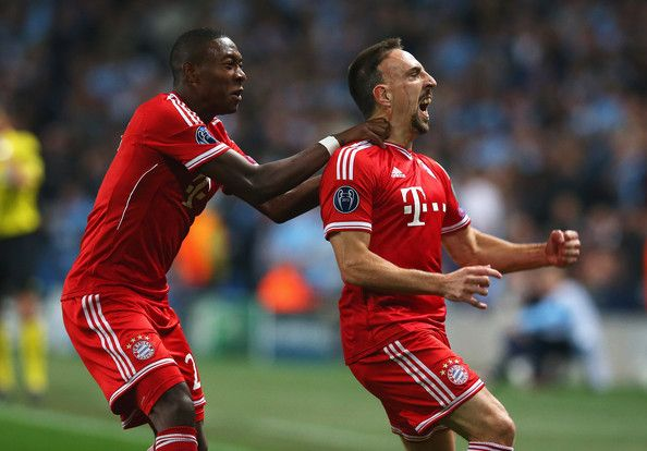 Franck Ribery (R) of Muenchen celebrates scoring the opening goal with David Alaba of Muenchen during the UEFA Champions League Group D match between Manchester City and FC Bayern Muenchen at Etihad Stadium on October 2, 2013 in Manchester, England.