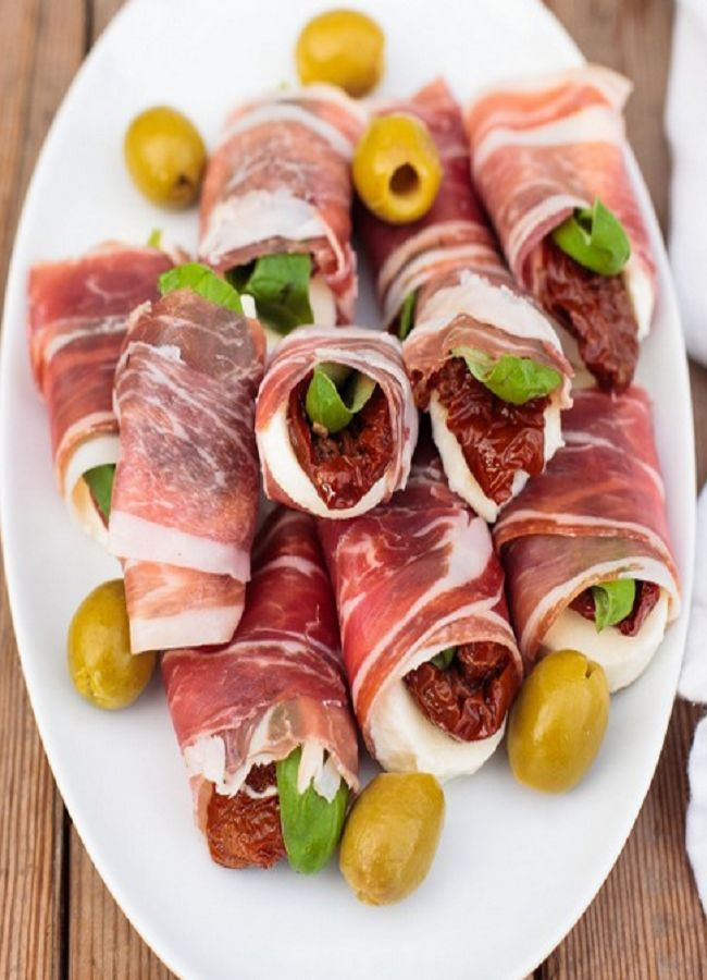 Fresh mozzarella, sun-dried tomatoes and basil leaves wrapped in prosciutto