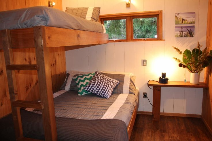 Comfy beds in a simple yet oh so stylish cabin. Hush, Coromandel, New Zealand