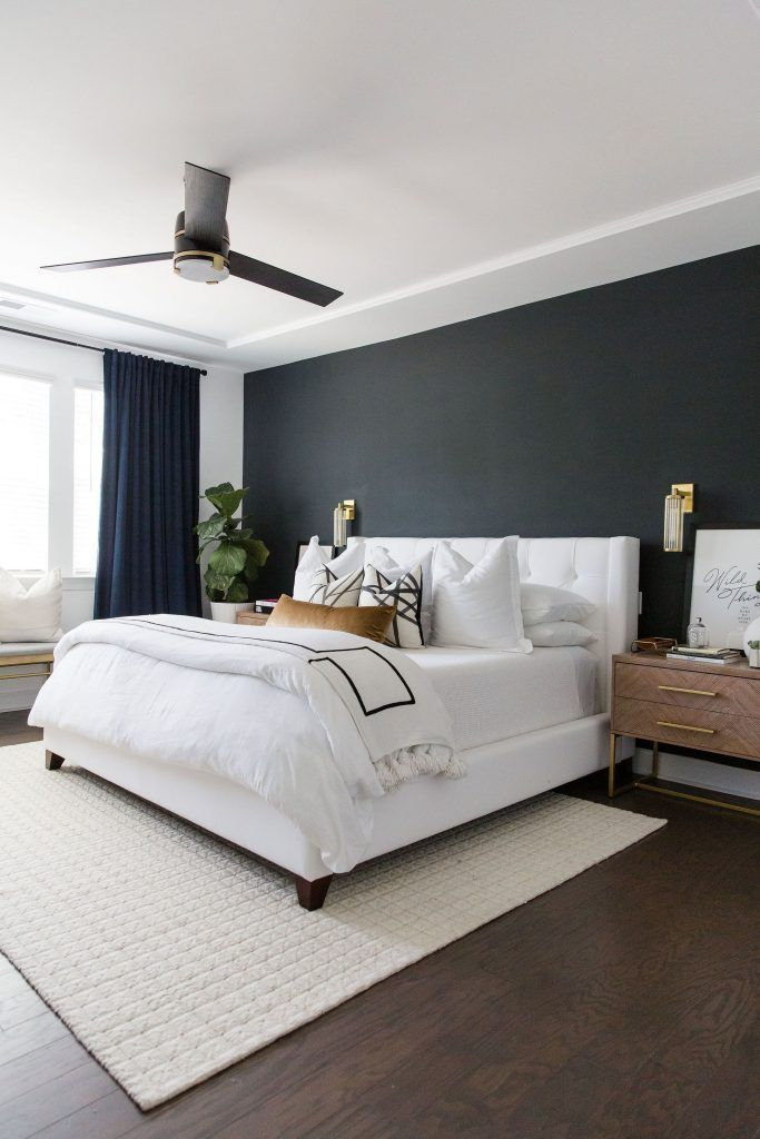 Sophisticated Bedroom With Ceiling Detail In Ivory And Noir Accent
