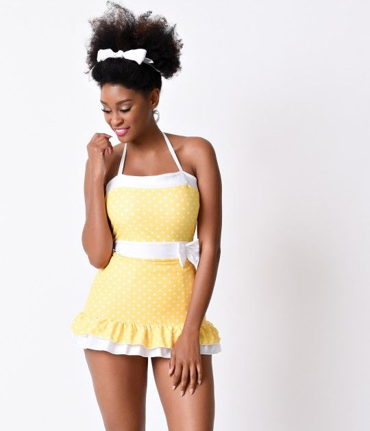 A vintage necessity, the Elaine retro halter bathing suit from Lolita Girl is nothing short of striking! A vintage 1950s inspired yellow swimsuit that's divinely dotted, with white contrast color blocking for a nipped in silhouette that's universally flat