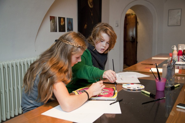 Two girls assigned to solve a creative task by their classmates